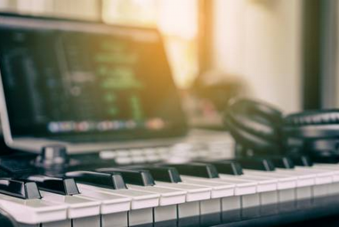 Why Music Producers Should Consider Picking Up An Instrument Themselves